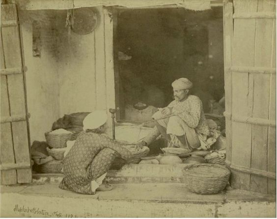 Man selling various products in his shop, Dehli, c. 1862.