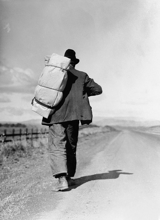 Migrant worker on California Highway by Dorothea Lange, 1935.