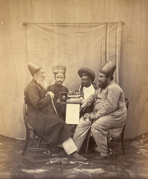 Studio portrait of three Parsees and a Parbhu, Bombay, Chintamon, 1867.